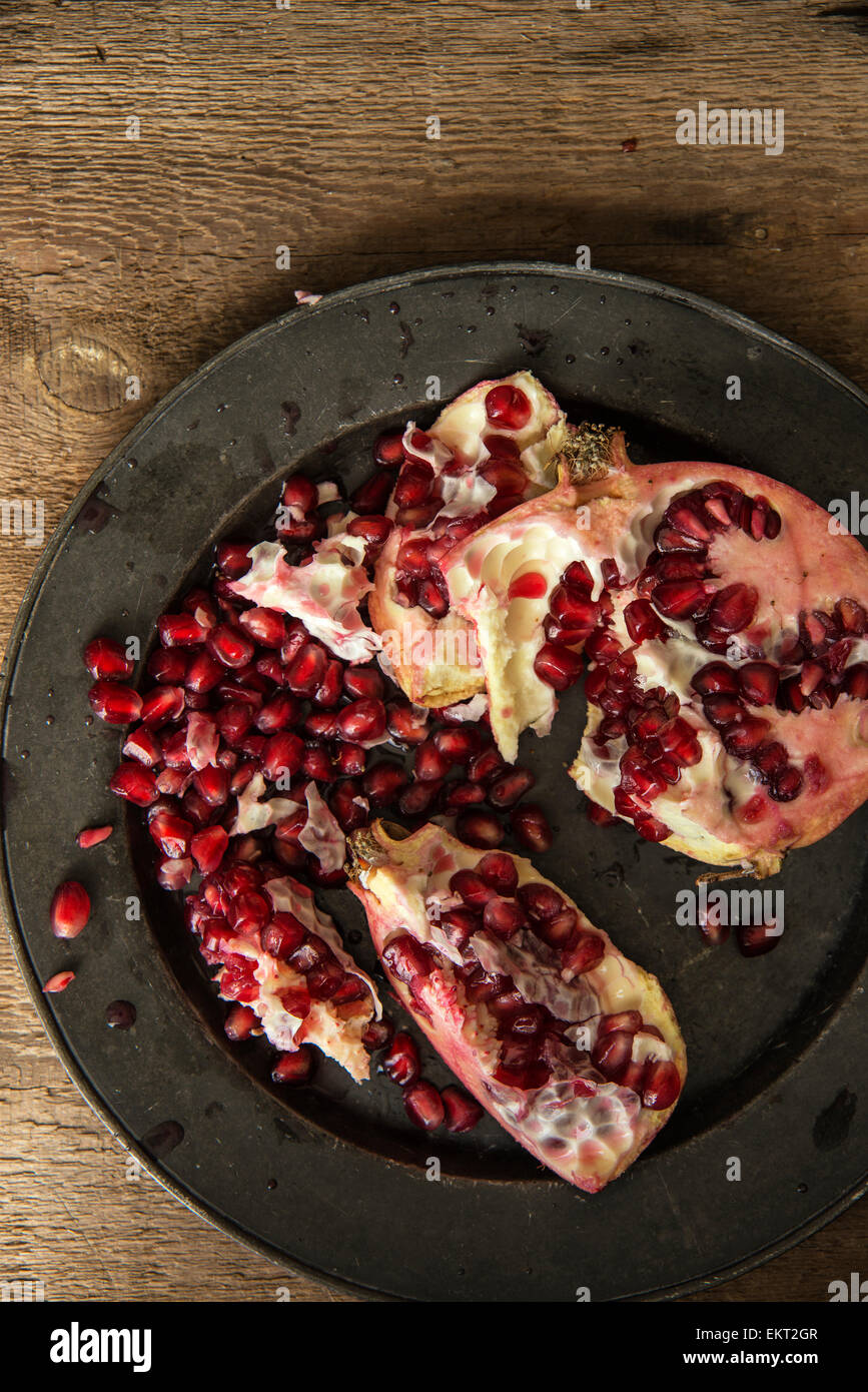 Moody natural lighting images of fresh juicy pomegranate with vintage style - Stock Image