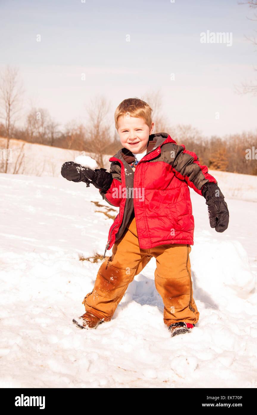 boy ready to  throw snowball - Stock Image