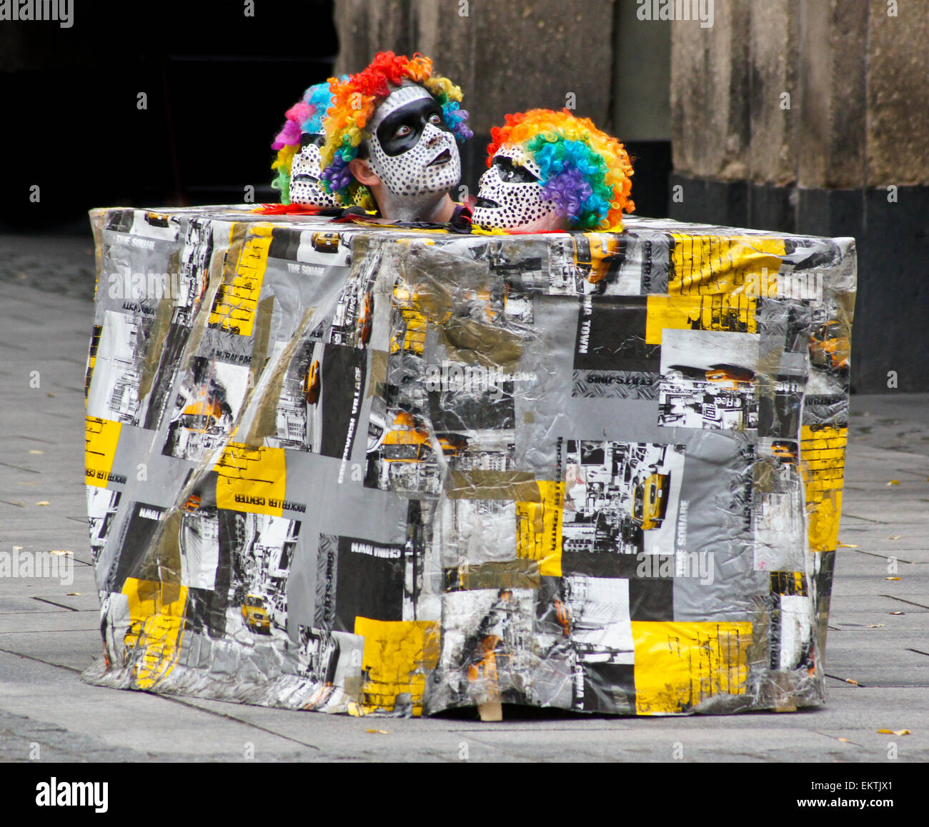 A mime artist and street entertainer in a box, Düsseldorf, Nordrhein-Westfalen, Germany - Stock Image