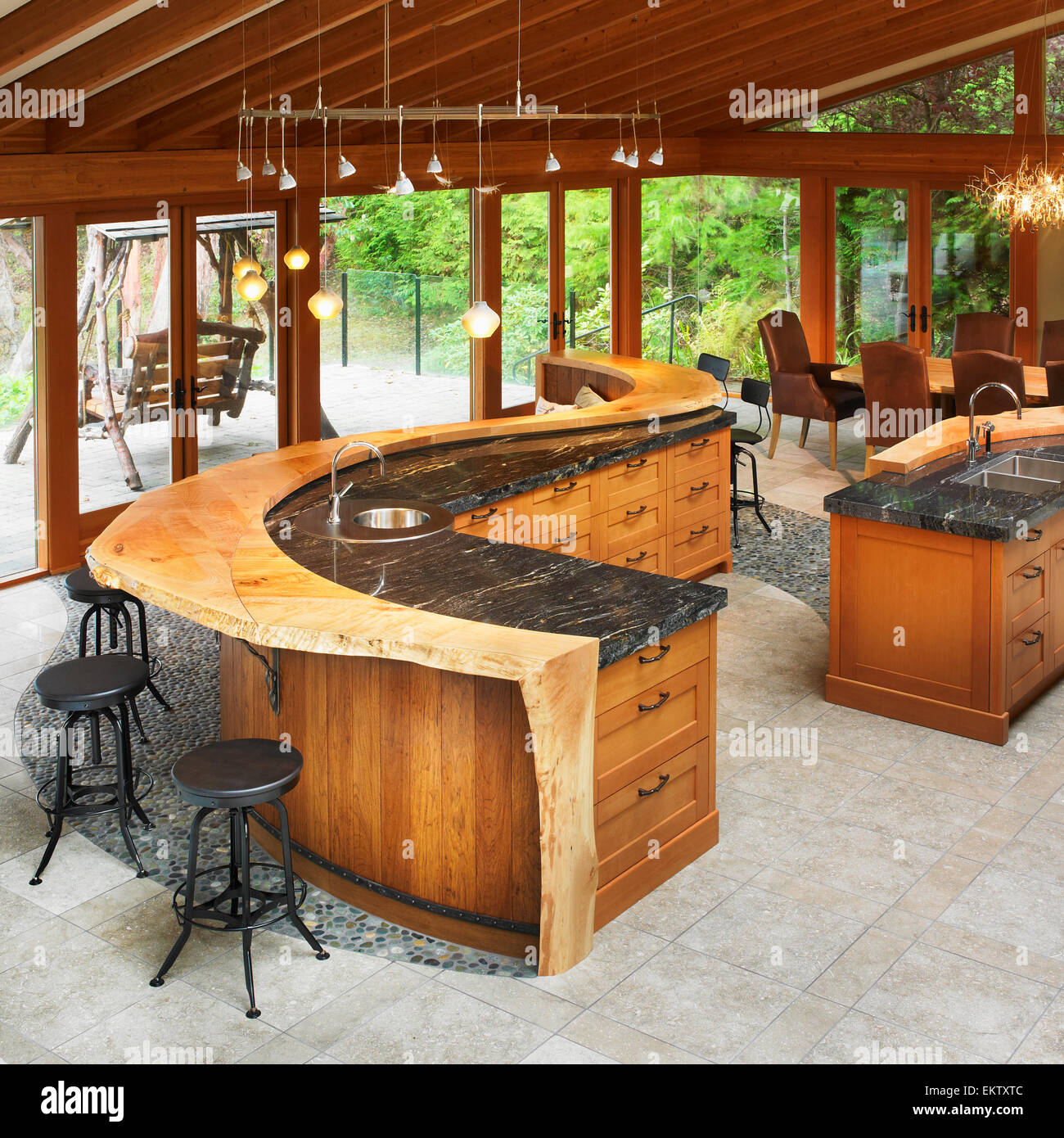 West Coast Style Kitchen With Curved Wood And Marble Stock Photo: 81067852