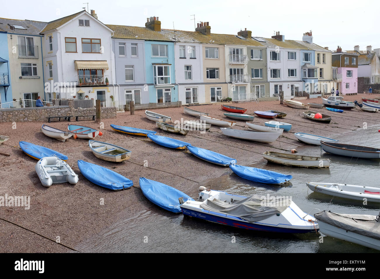 Boats against coloured homes in Teighmouth Devon - Stock Image