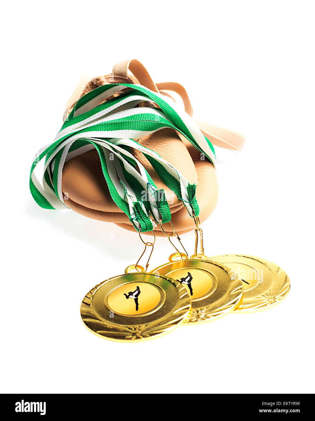 Gold Medals with  Gym shoes on White background - Stock Image