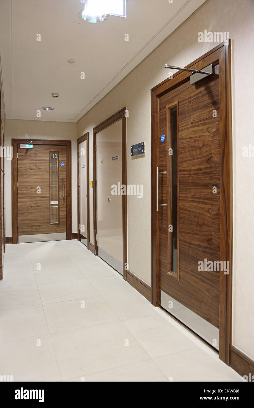 Hardwood And Plastic Faced Fire Doors In The Lobby Of A New Central London Luxury  Apartment Block.
