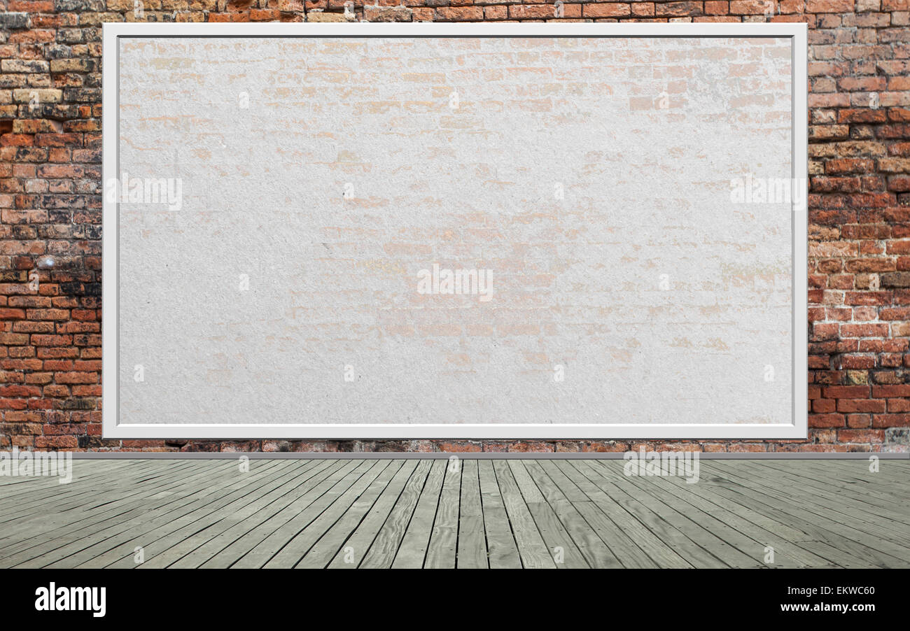 Street scene with Red brick wall and empty billboard - Stock Image