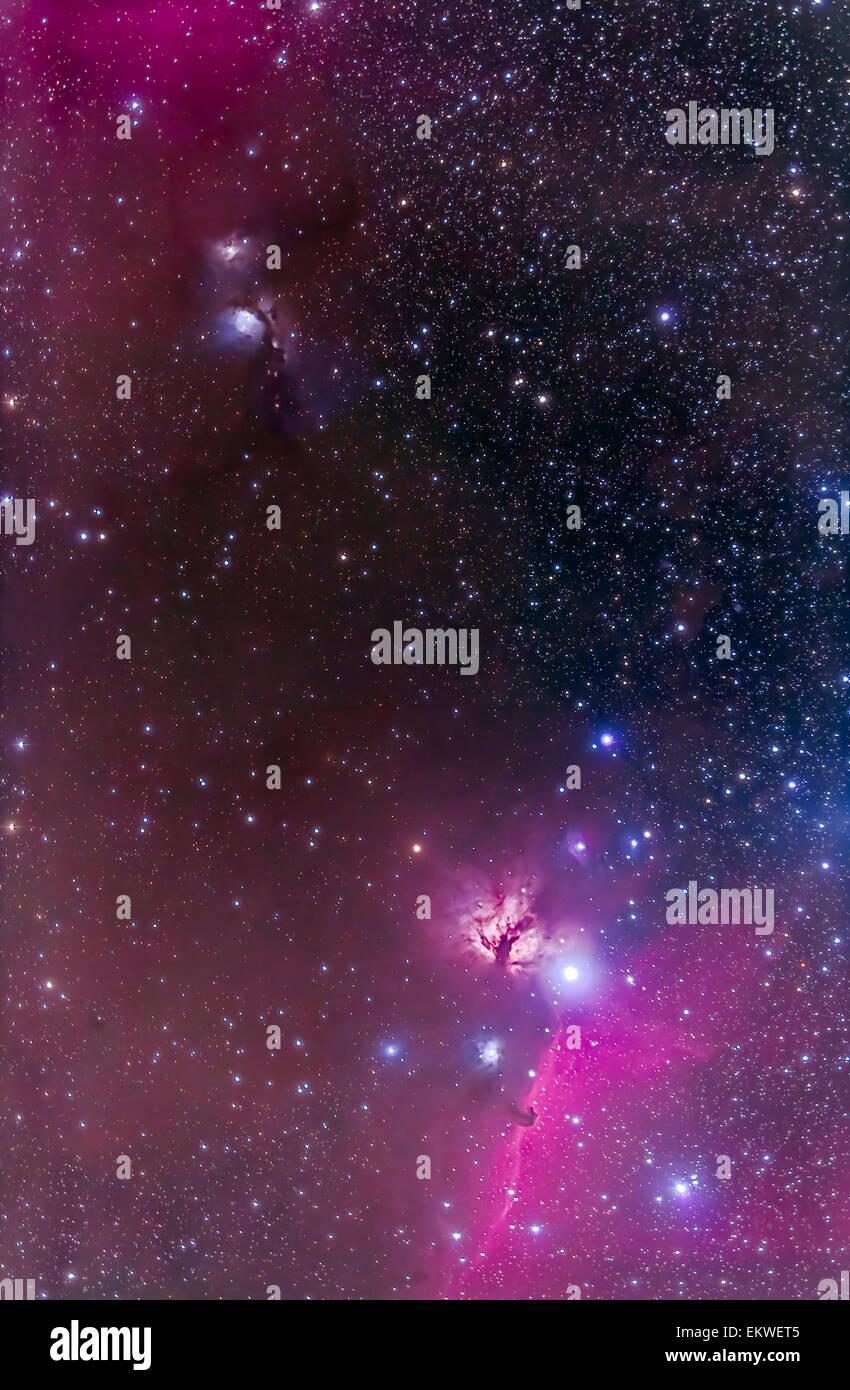 The Horsehead Nebula (B33) at bottom, below the star Zeta Orionis (aka Alnitak, the left star of Orion's Belt), - Stock Image