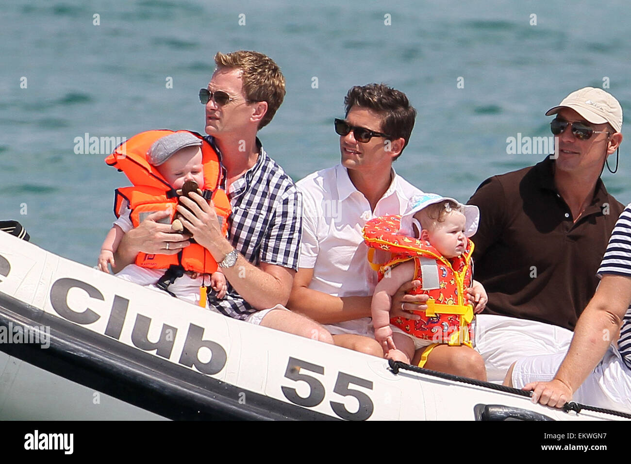 04.AUGUST.2011. ST TROPEZ  ELTON JOHN AND DAVID FURNISH AND BABY ZACHARY WITH THEIR FRIENDS NEIL PARTICK HARRIS - Stock Image