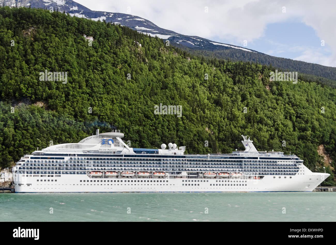 Cruise Ship Island Princess belonging to Princess Cruises tied up to Railroad Dock in Skagway Alaska - Stock Image