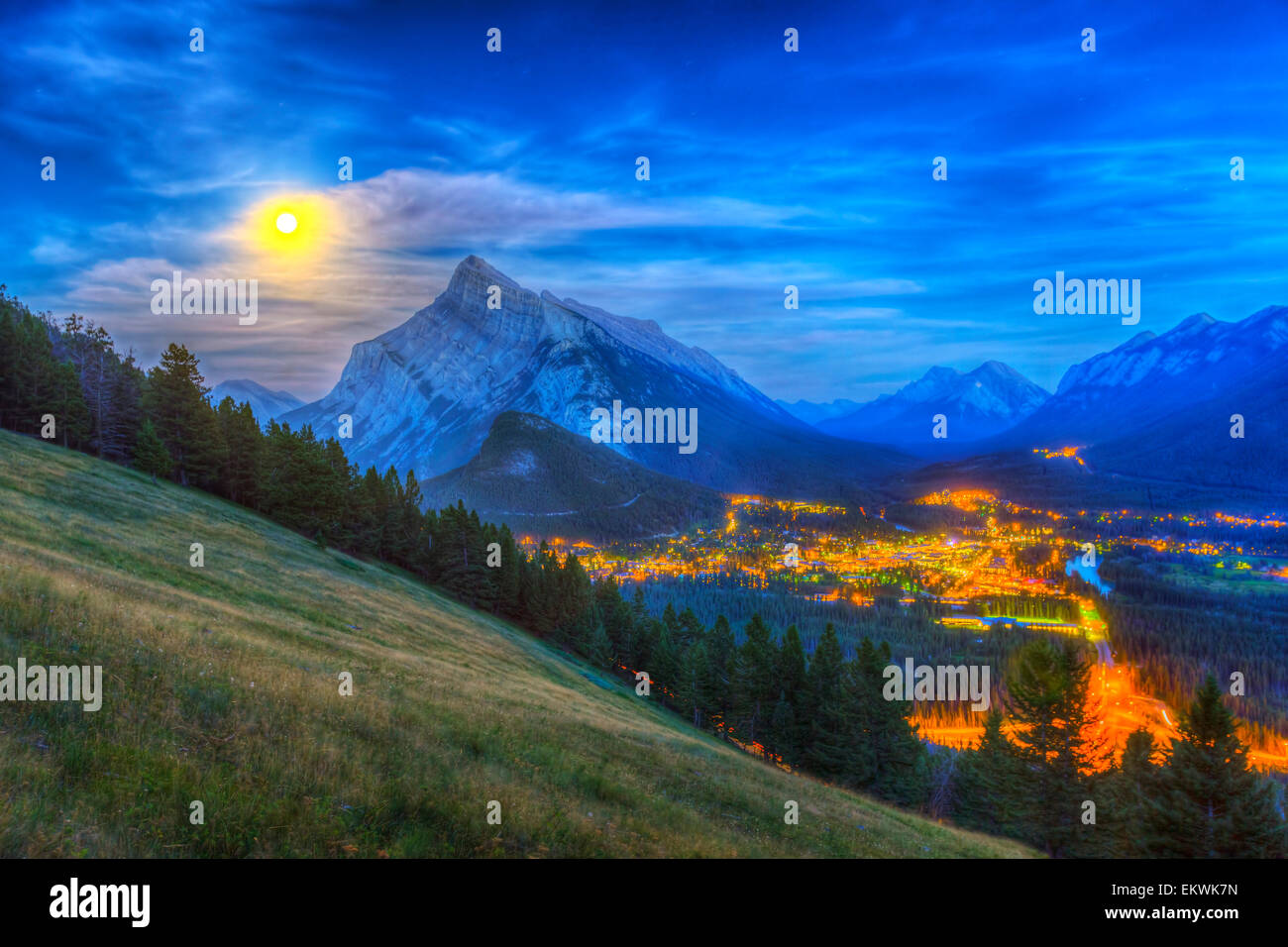 August 10, 2014 - High dynamic range photo of the supermoon rising behind Mt. Rundle and Banff townsite, as seen - Stock Image