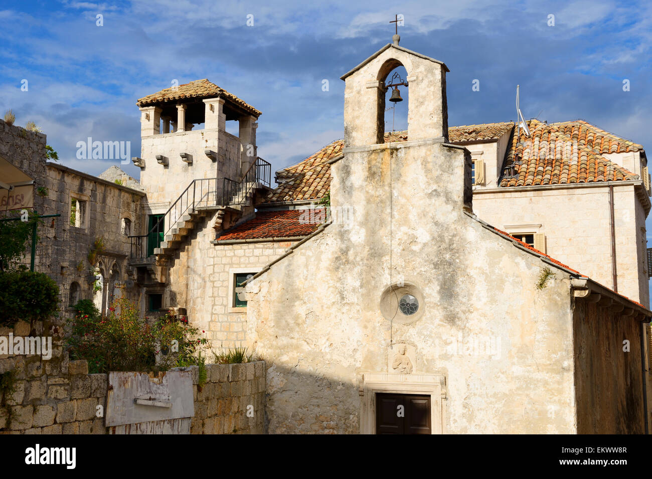 Church of All Saints and Marco Polo Tower in old town of Korcula on Dalmatian Coast of Croatia - Stock Image