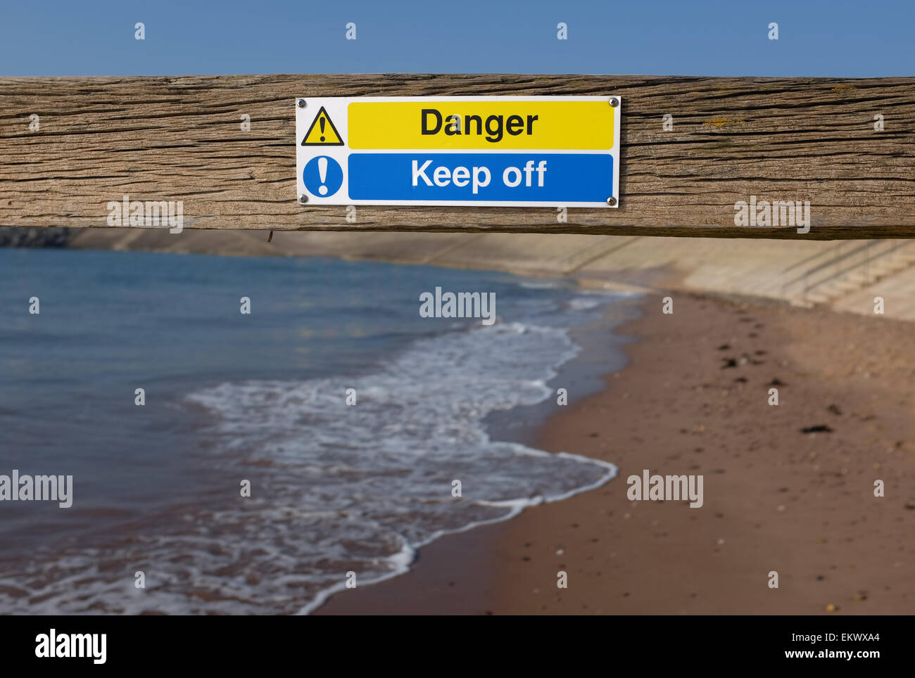 Danger keep off sign on a groyn at a beach in Dawlish Warren Devon England UK - Stock Image