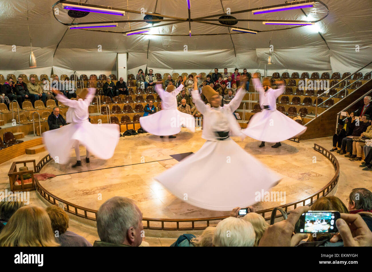 Whirling Dervishes and tourists, Pamukkale, Turkey - Stock Image