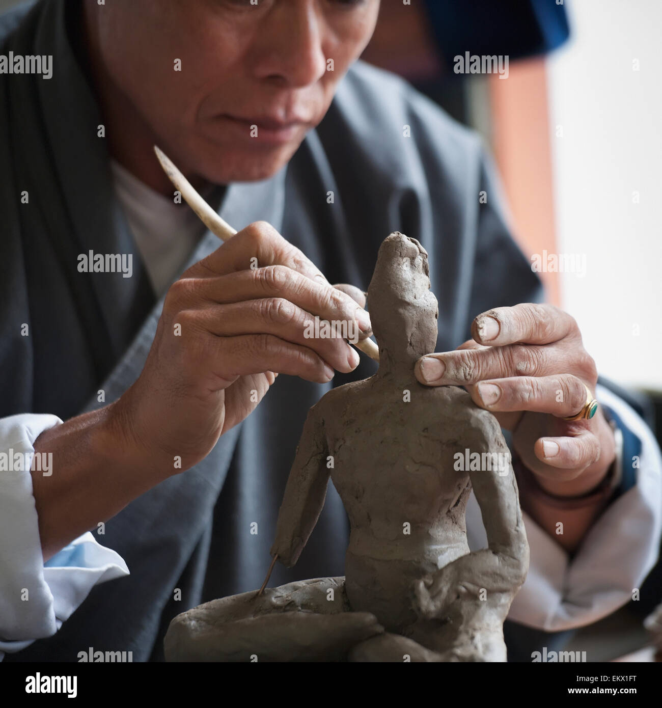 Art Student Sculpting A Clay Figure In National Institute Of Zorig Chusum; Thimphu Bhutan Stock Photo