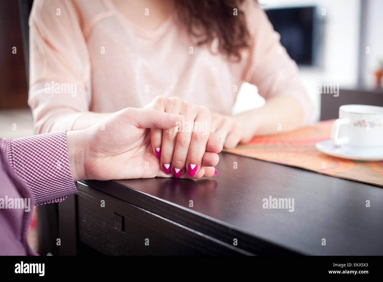 Engaged Couple Holding Hands Restaurant Stock Photos & Engaged ...