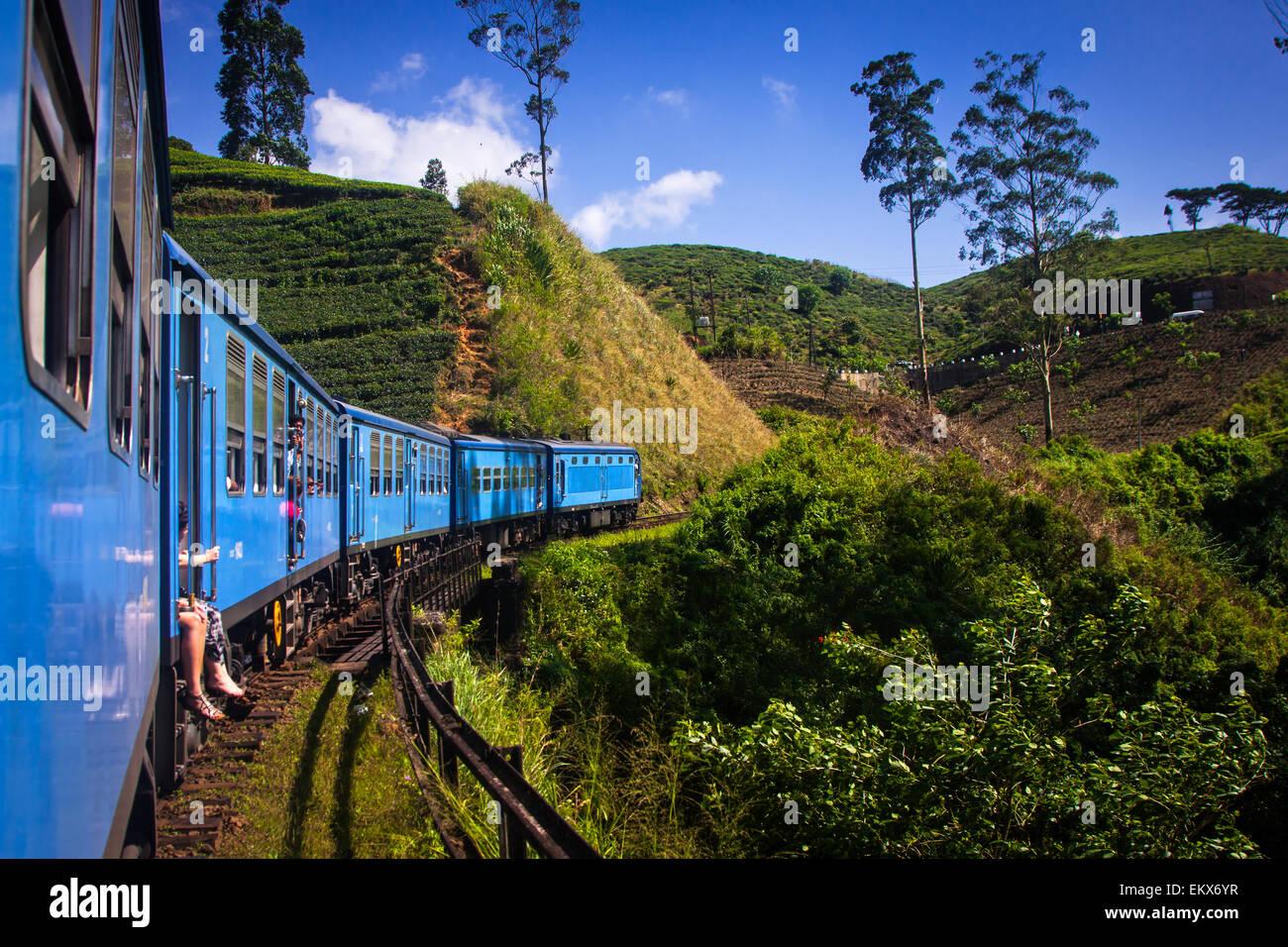 train from Nuwara Eliya to Kandy among tea plantations in the highlands of Sri Lanka - Stock Image
