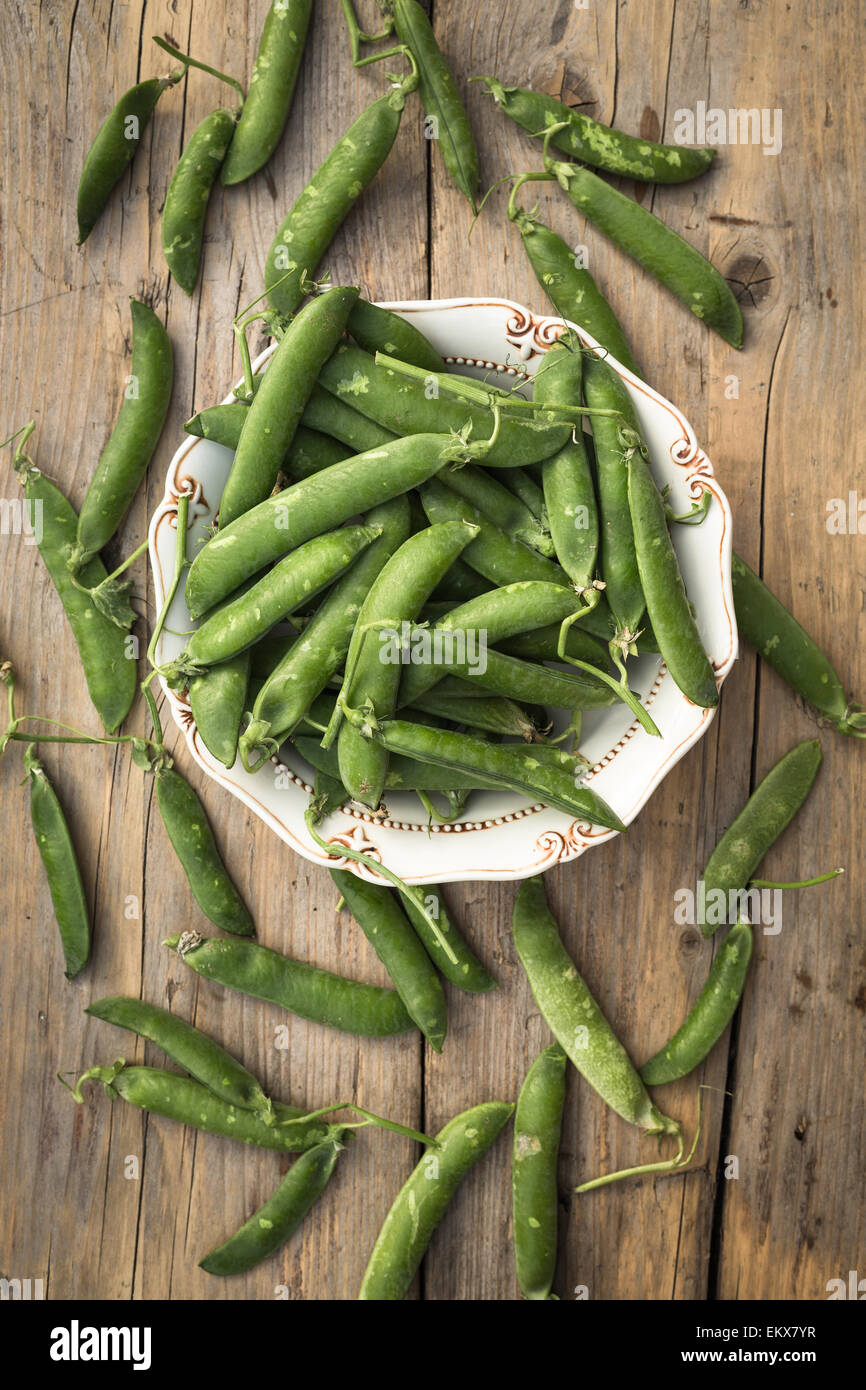 Fresh peas in a bowl - Stock Image