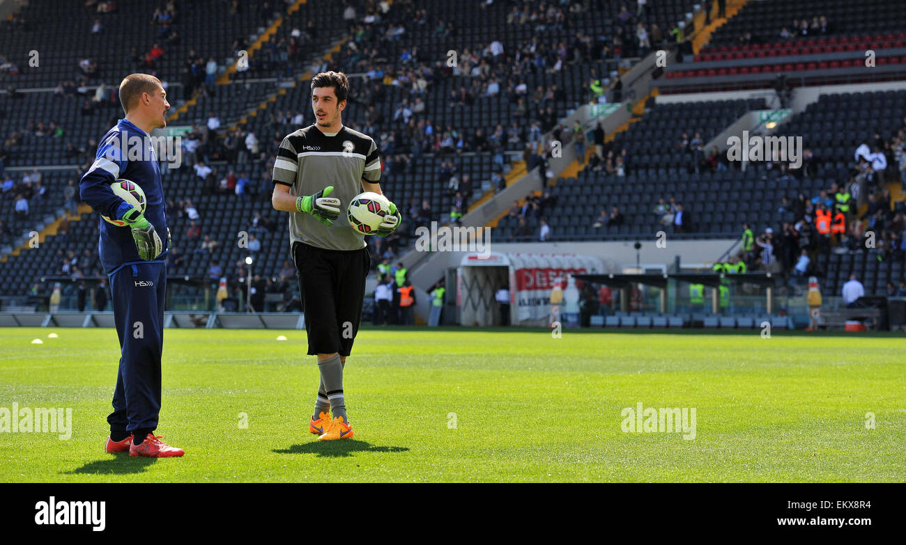 Udinese's italian goalkeeper Simone Scuffet speacks with Udinese's goalkeepers trainer Alex Brunner before - Stock Image