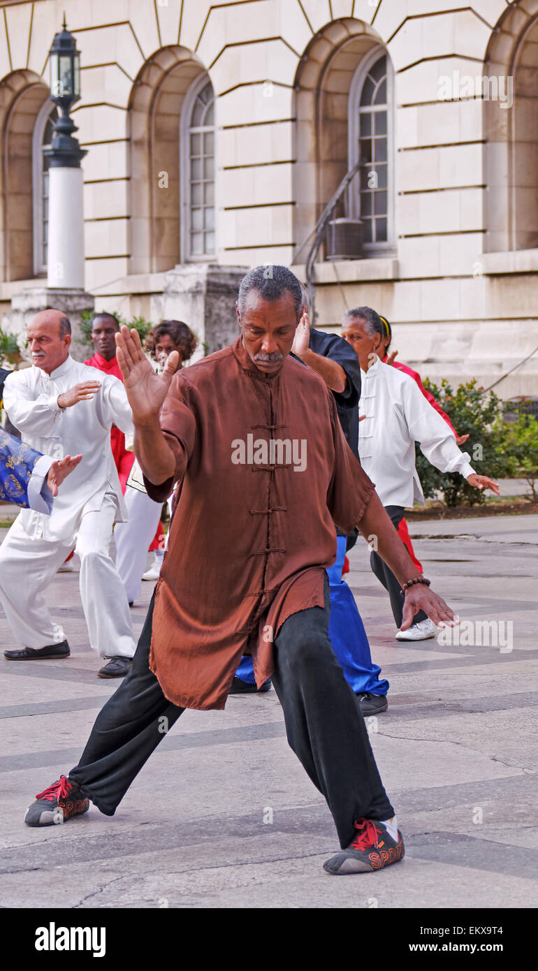 man in brown tunic  uniform performing Tai Chi exercises in Havana, Cuba - Stock Image