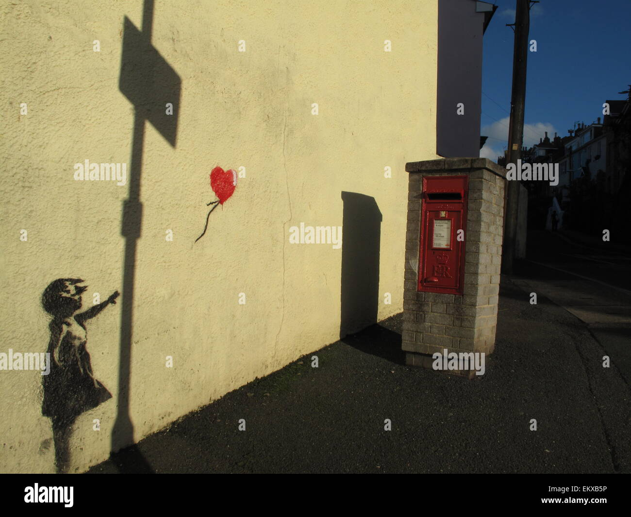 A Banksy mural of girl with red balloon on wall in Brixham Devon ...
