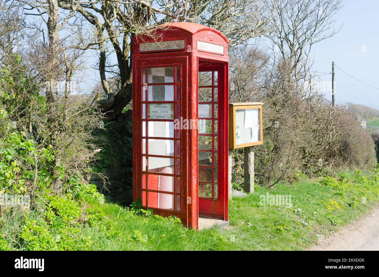 Old telephone box used for parish council notices in the Devon village of East Prawle - Stock Image