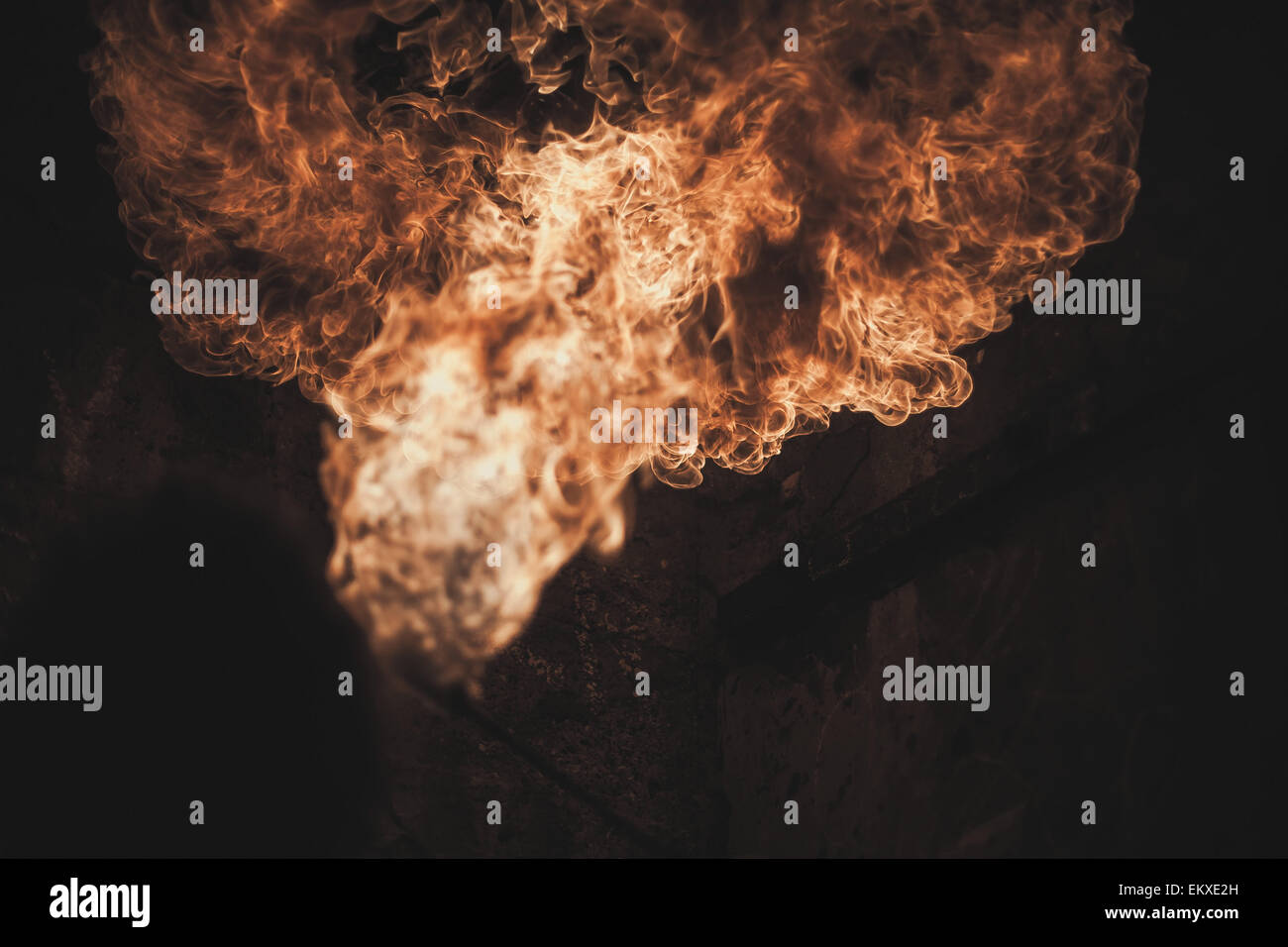 close up fire breathe in an industrial setting - Stock Image