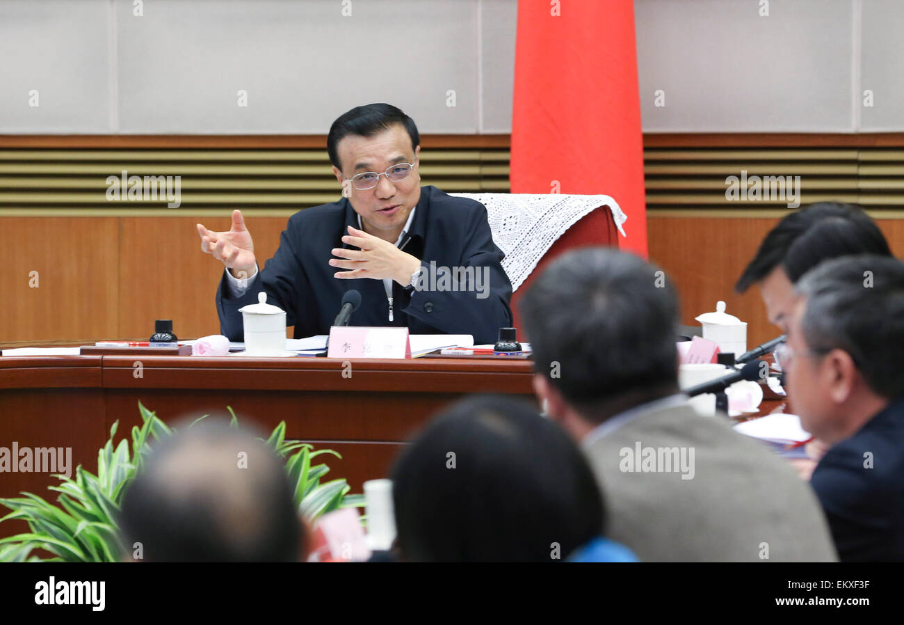 Beijing, China. 14th Apr, 2015. Chinese Premier Li Keqiang presides over a symposium on current economic situation - Stock Image