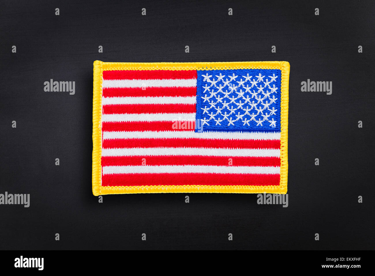 American flag on a dark background - Stock Image
