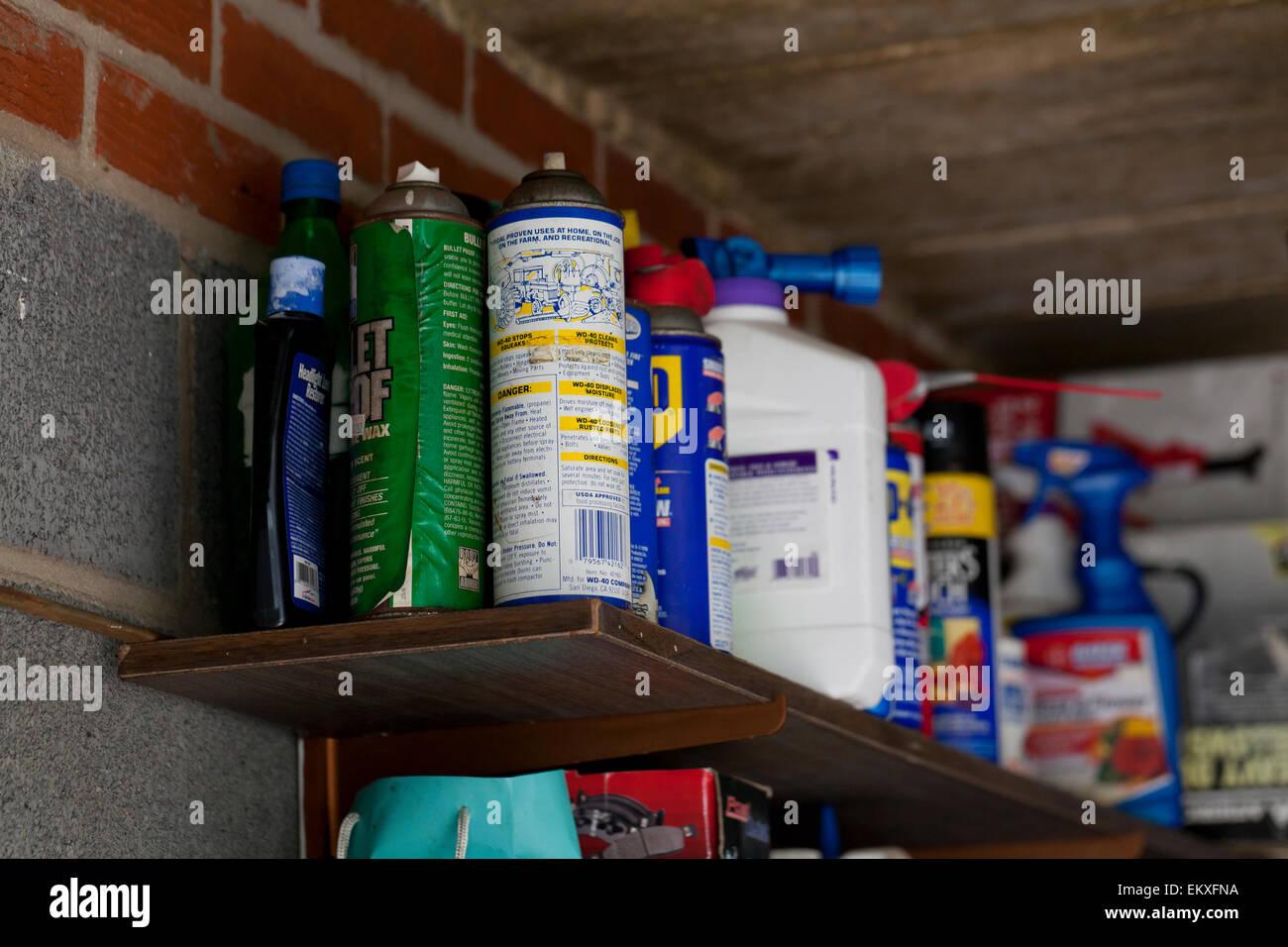Chemicals stored on garage shelf - USA - Stock Image
