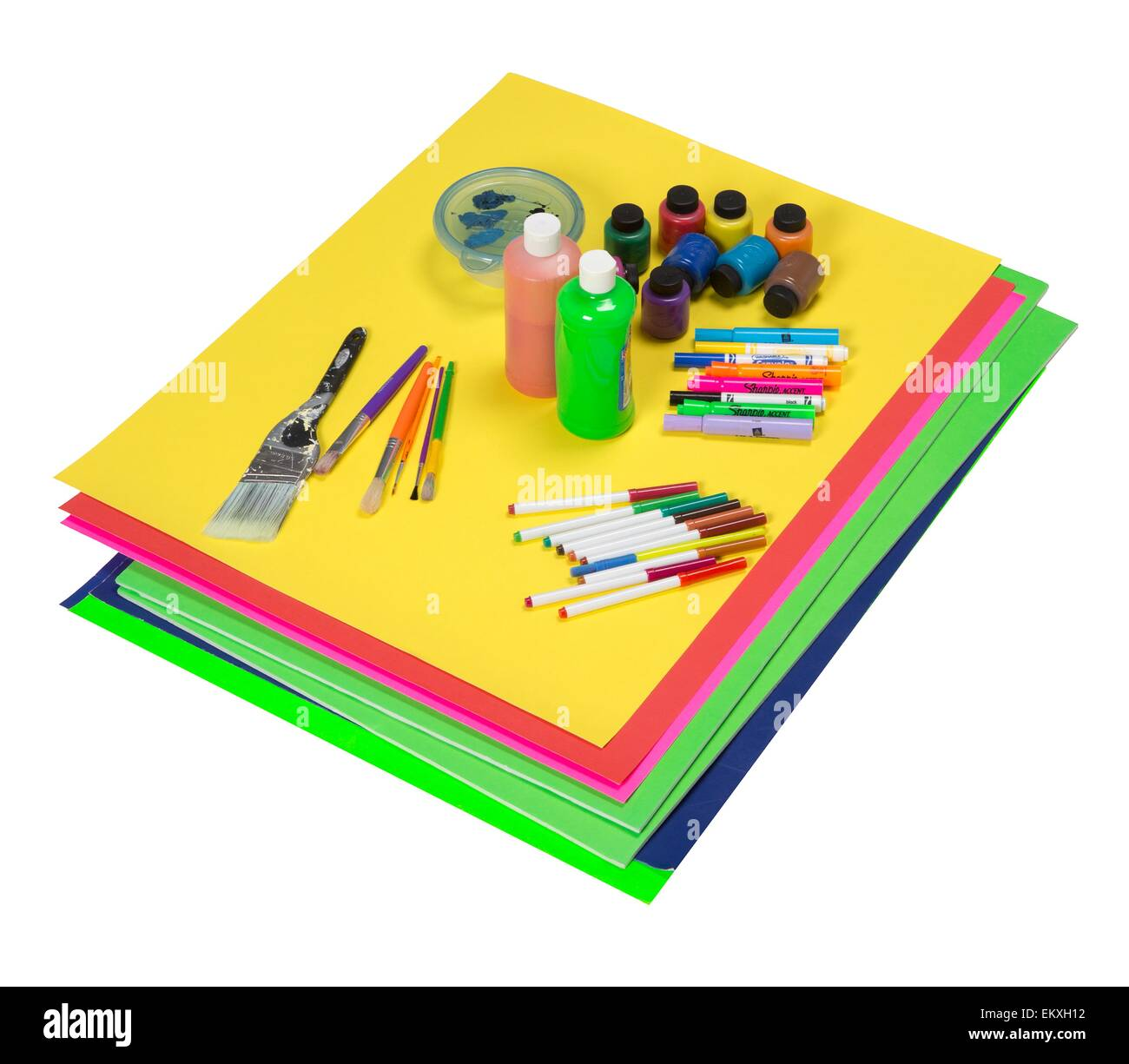 Art supplies which include colorful poster boards, paint, markers, and brushes - Stock Image
