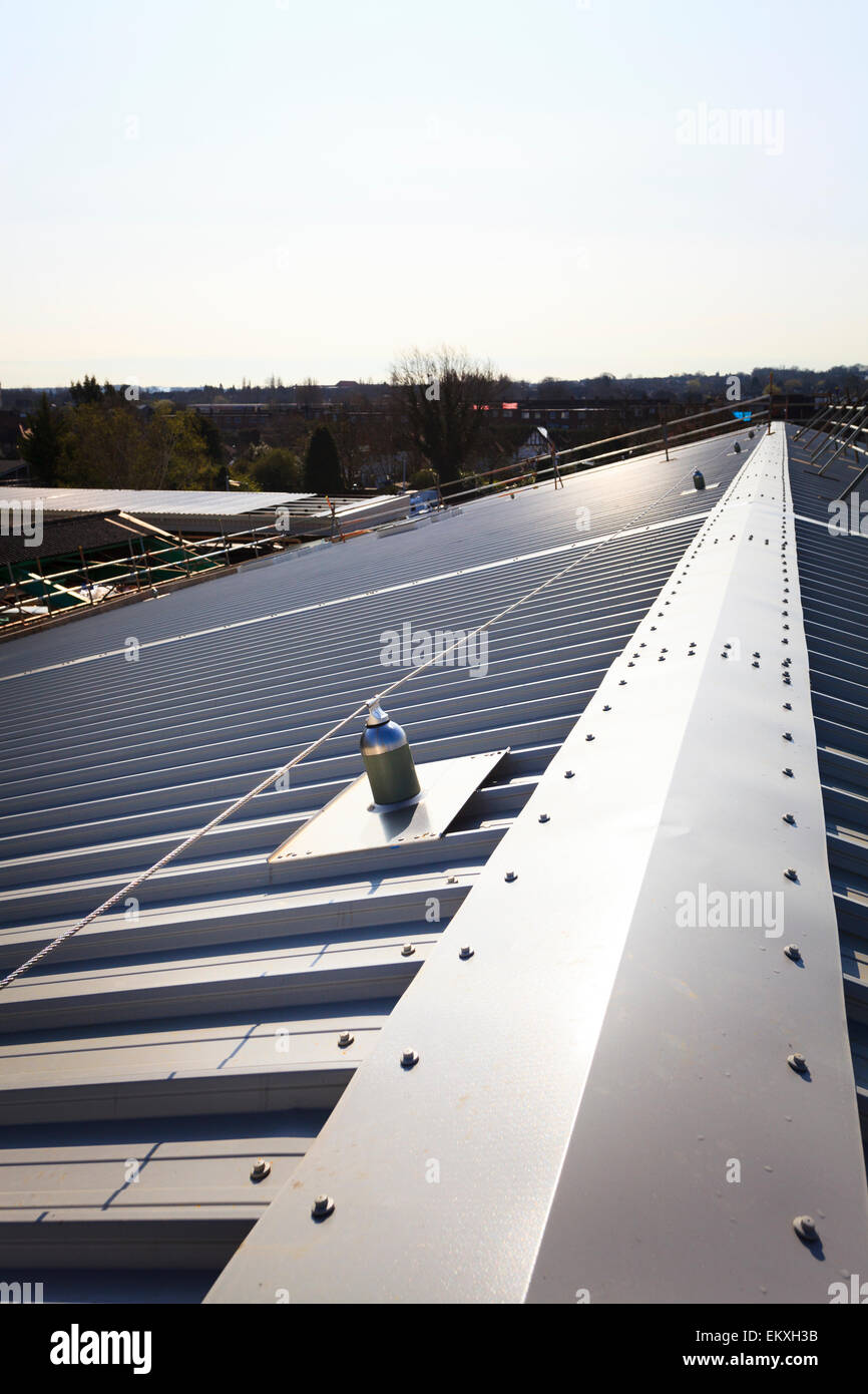 Standing seam roofing with fall arrest blocks and safety wire Stock ...