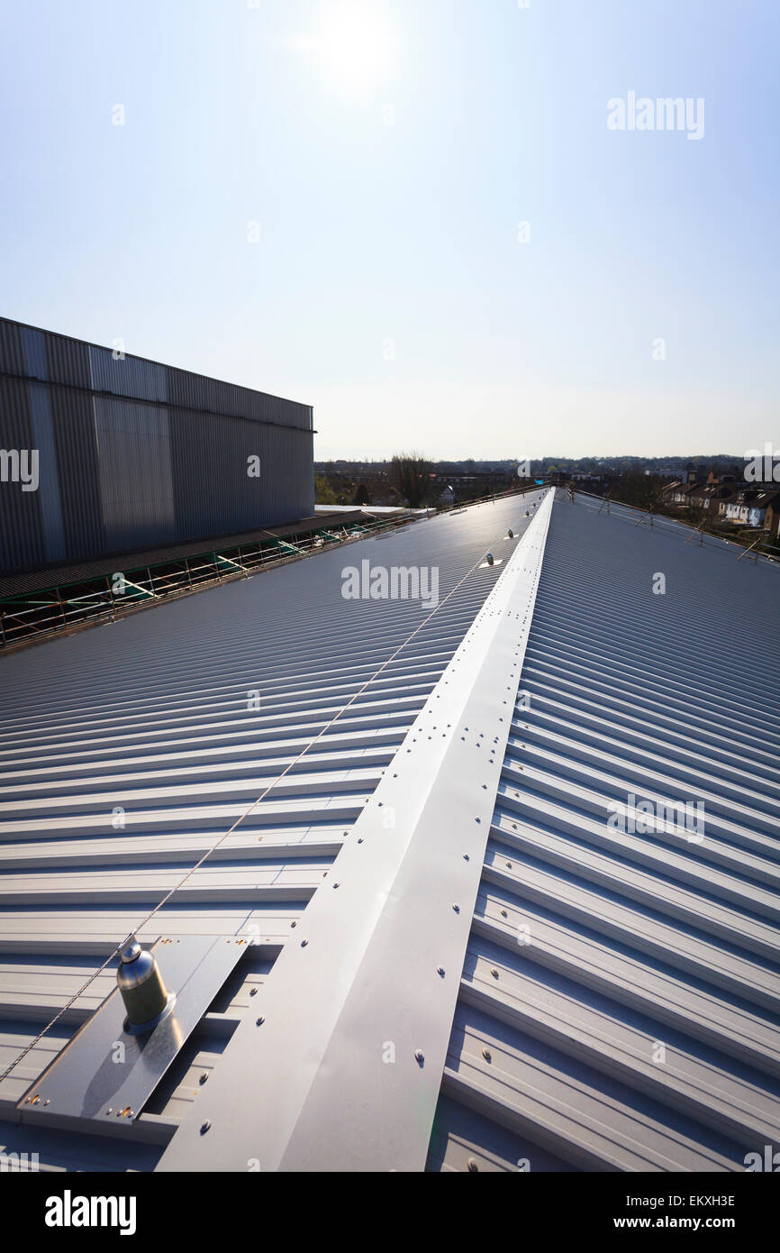 Standing seam roofing with fall arrest blocks and safety wire - Stock Image