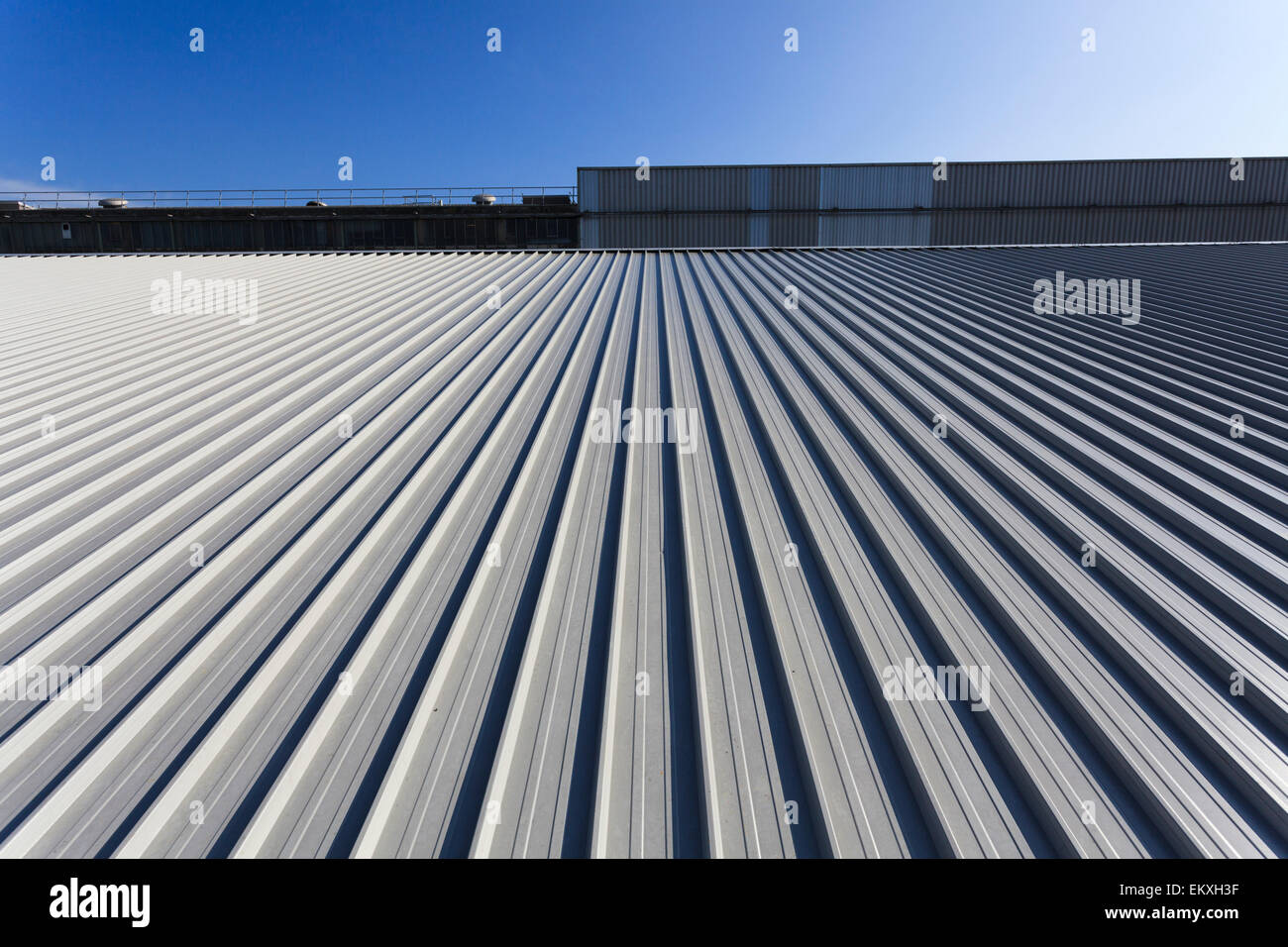 Standing seam roofing with fall arrest blocks and safety wire Stock Photo