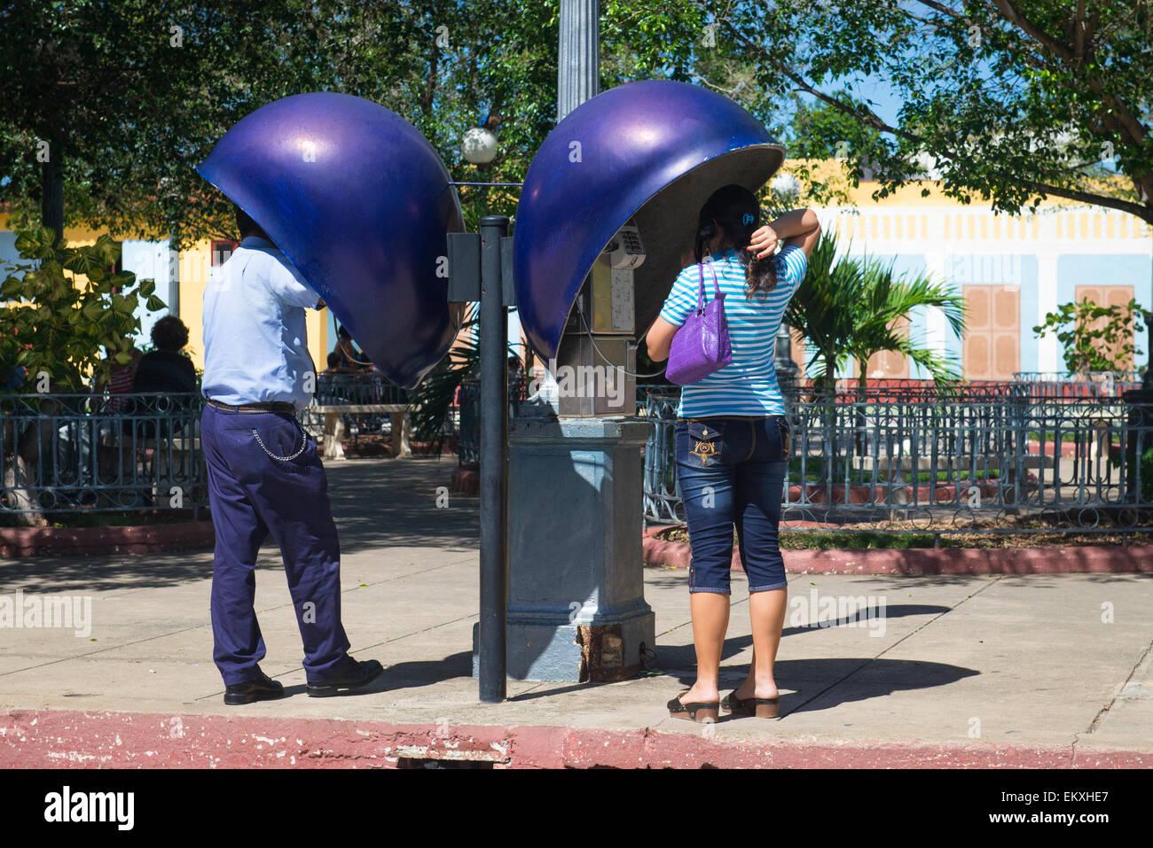 Cuba Trinidad Plaza Carrillo street road scene public phone telephone kiosk kiosks booth booths callers - Stock Image