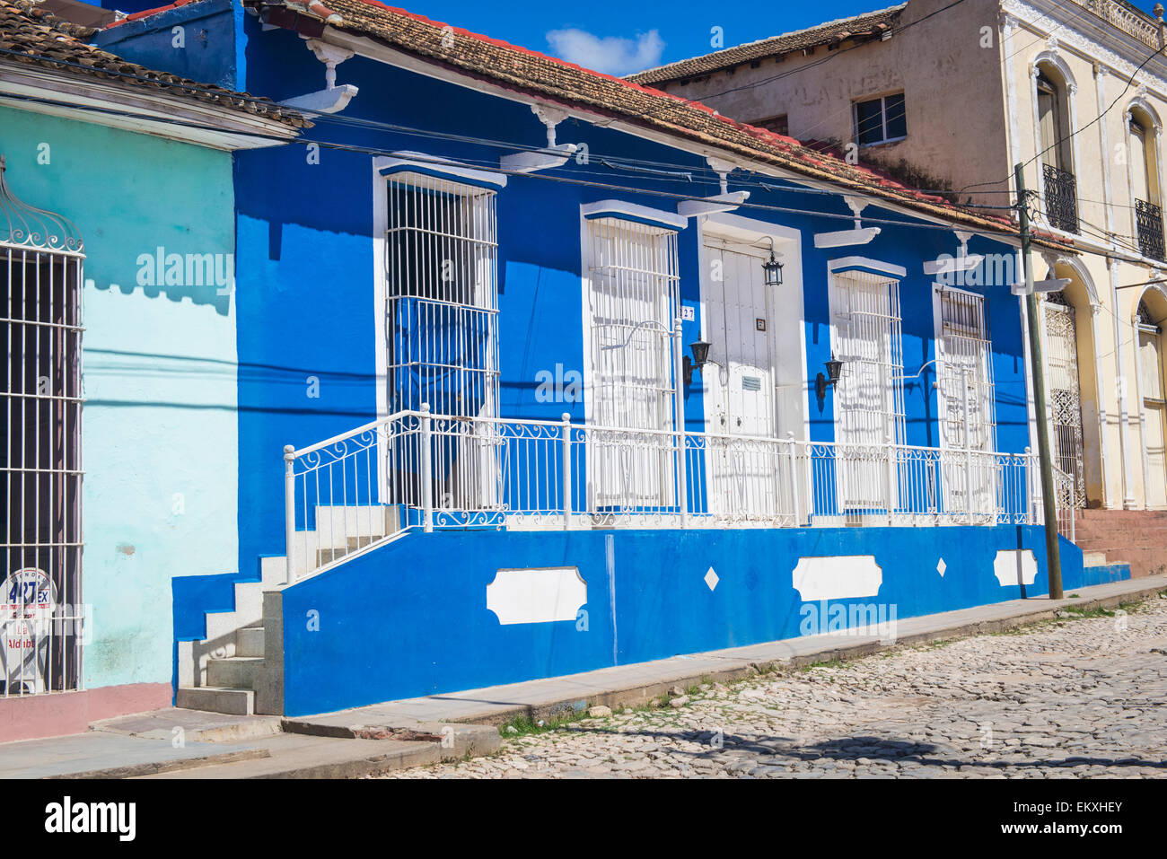 Cuba Trinidad typical street road scene wooden shutters metal bars ...