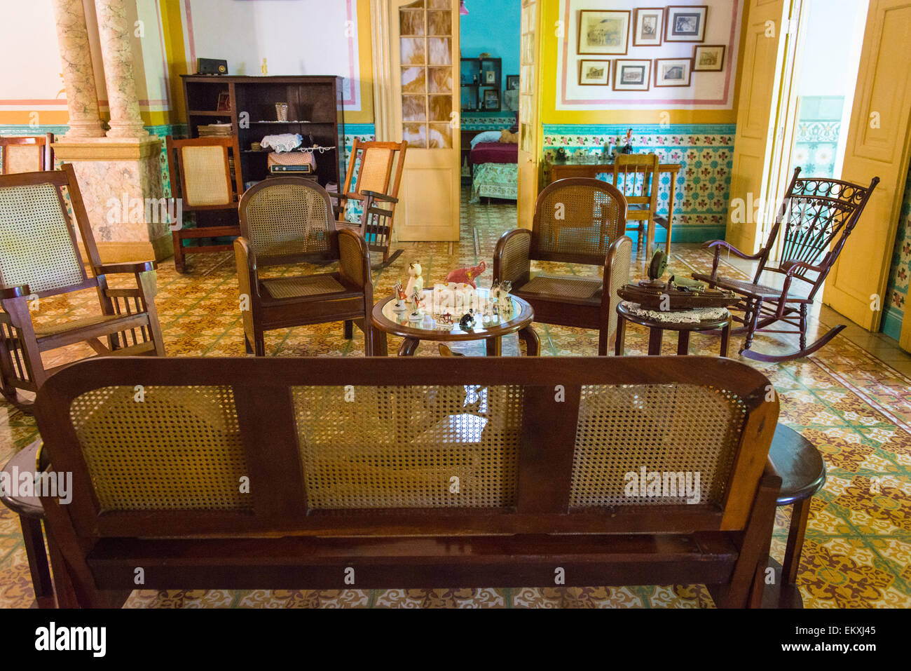 Cuba Trinidad typical Cuban home old antique furniture ornate walls & tiles lamp shades rocking chairs table - Stock Image