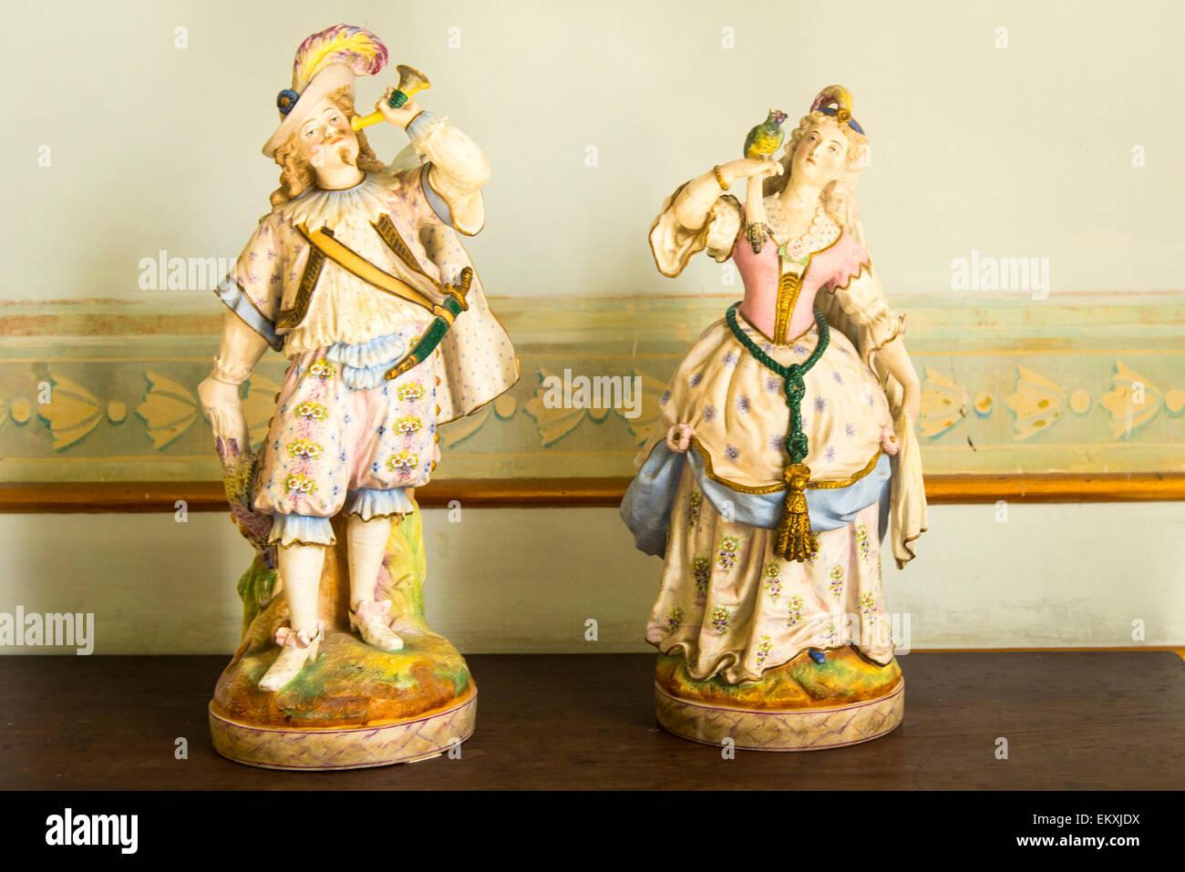 Cuba Trinidad Palacio Cantero Museo Historica Municipal antique two porcelain figures figurines hunter & lady - Stock Image