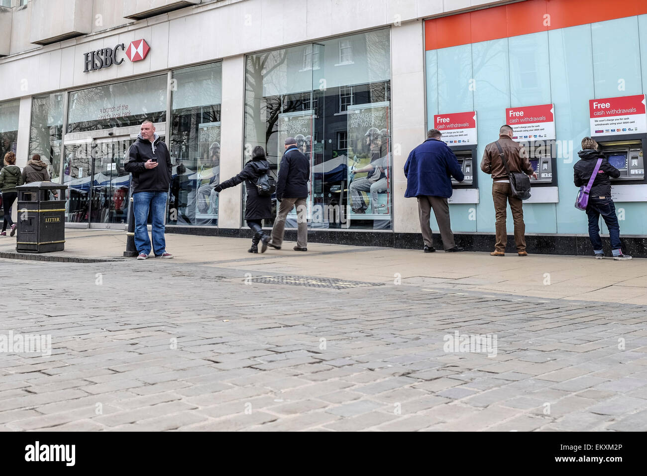 HSBC bank - York main branch in the city centre with people using cashpoints ATMs a cashpoint ATM. Stock Photo