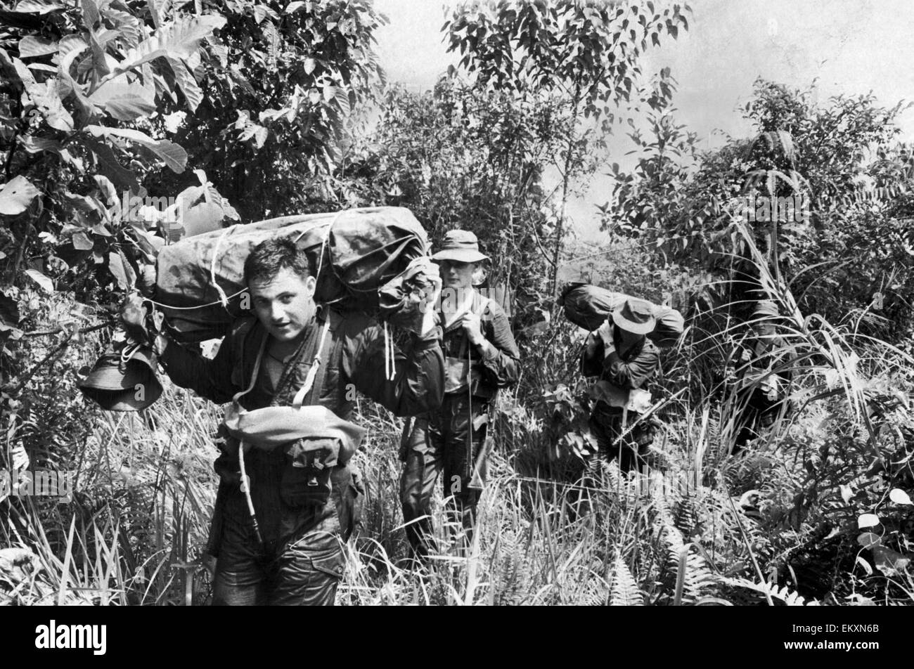 Emergency in Malaya. Soldiers of the British Army seen here on patrol in the Malayan Jungle following unrest. 17th - Stock Image
