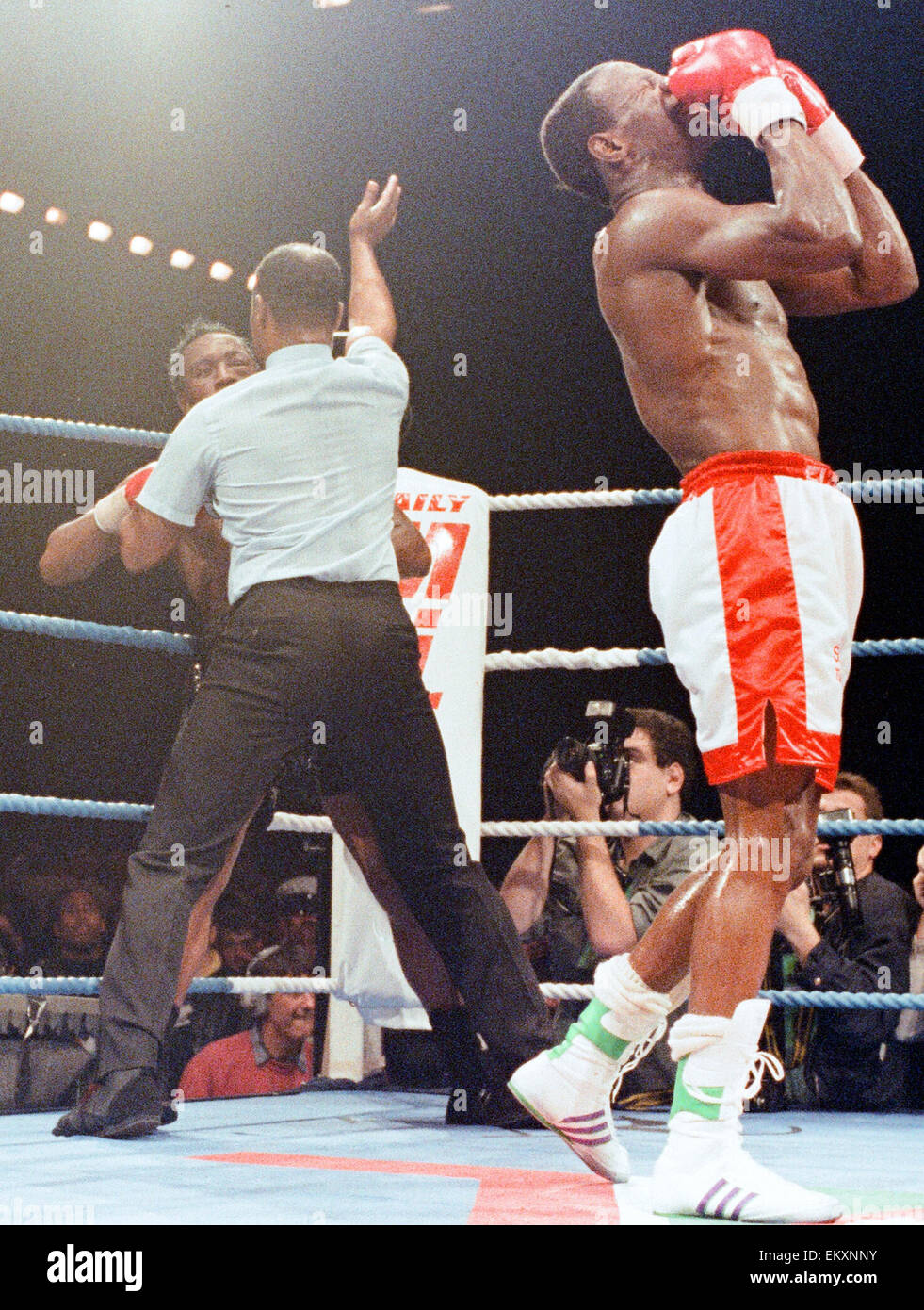 The referee stops the bout as Chris Eubank celebrates his victory over Nigel Benn the NEC in Birmingham. 18th November - Stock Image