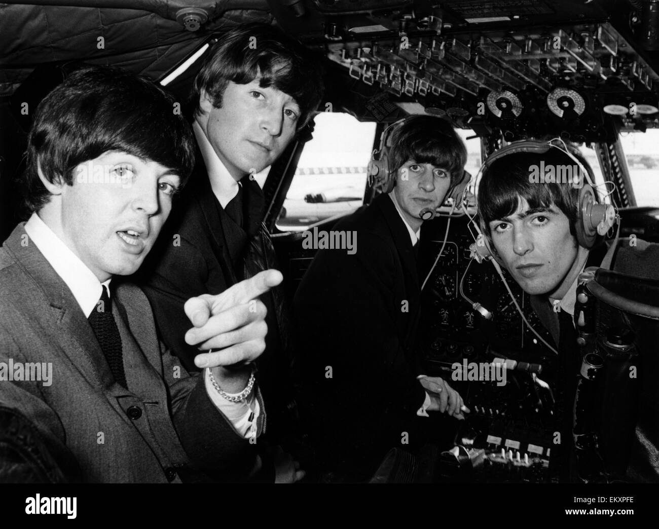 Beatles pop band in the cockpit of an aircraft on the way to the Northern Premiere of a 'Hard day's Night' - Stock Image