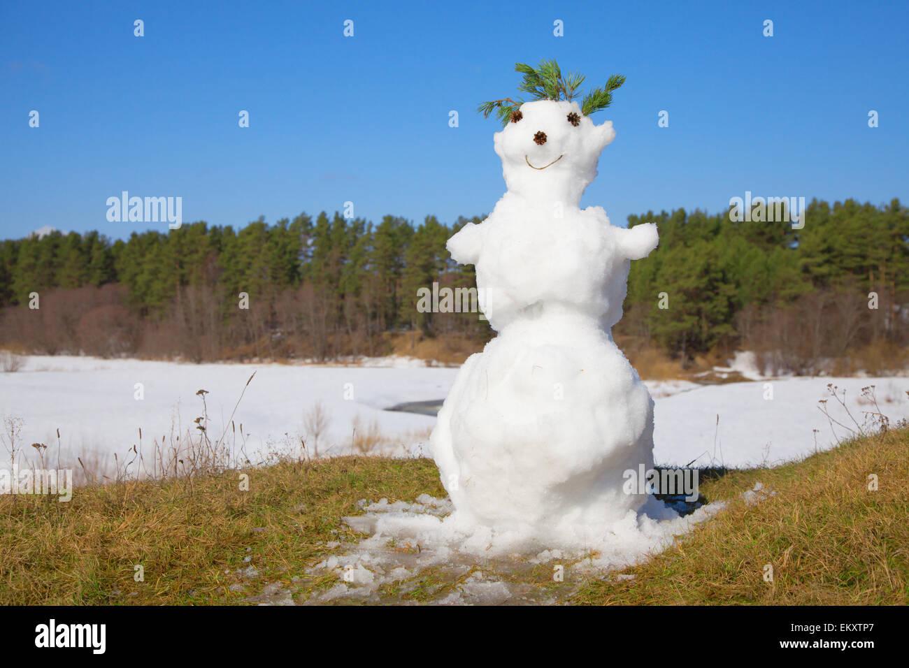 spring melt snowman - Stock Image
