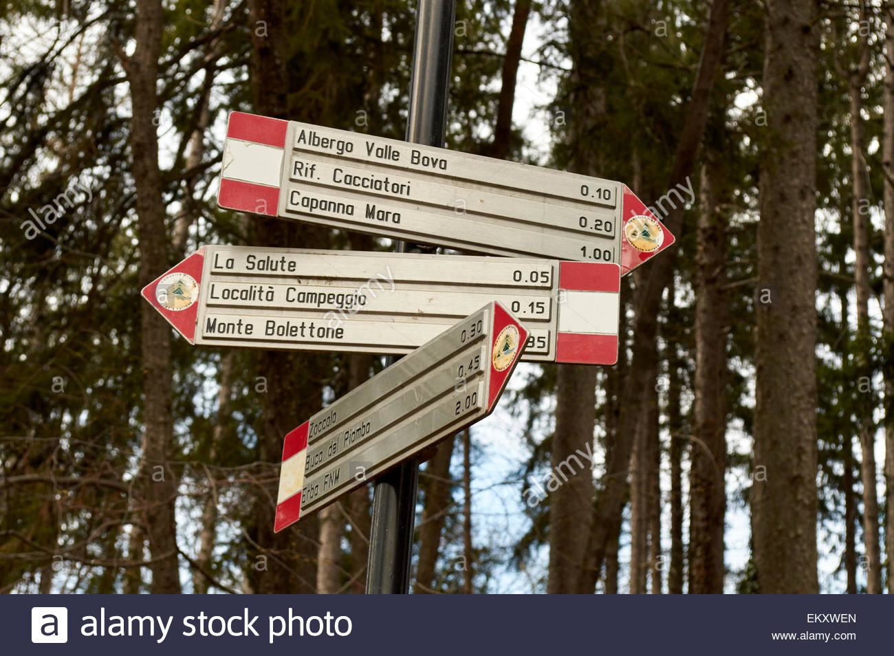 Indication signals for hikers in the woods of the Prealps in province of Como Lombardy region Italy - Stock Image