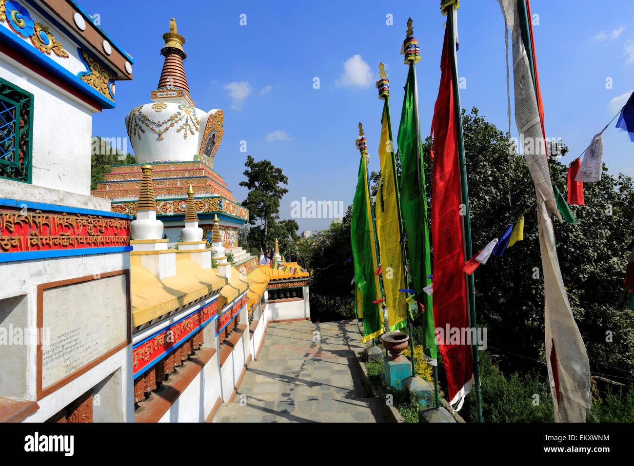 Part of the 245 foot long prayer wheel wall and Buddhist Stupas built by the Mangyul Kyidong Welfare Association, - Stock Image