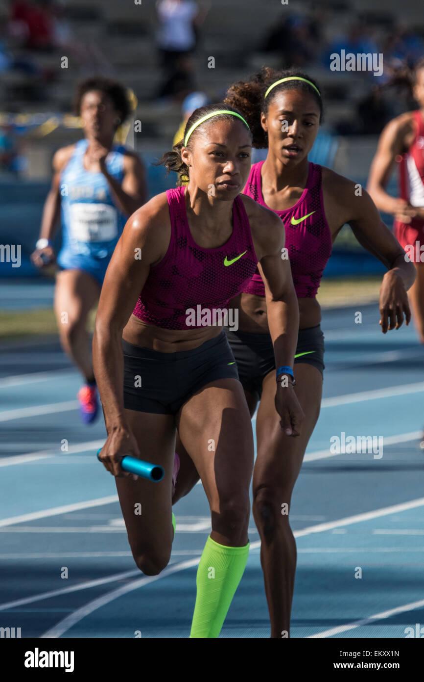 Allyson Felix takes the baton during a relay race at Drake Stadium UCLA during the Rafer Johnson/Jackie Joyner-Kersee - Stock Image