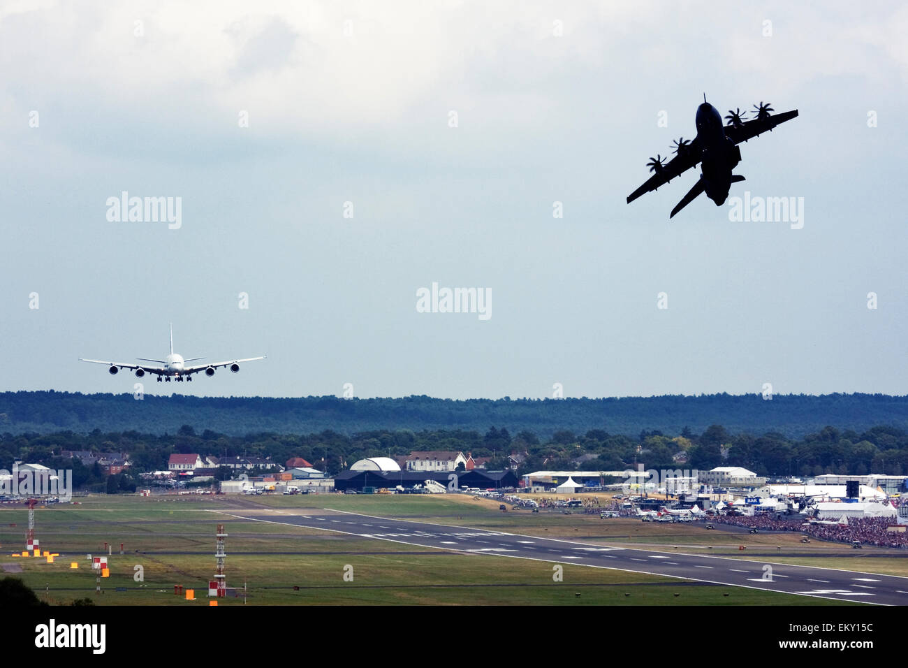 Airbus A380 landing while Airbus A400M Atlas takes off for a display at Farnborough International Airshow 2015 - Stock Image