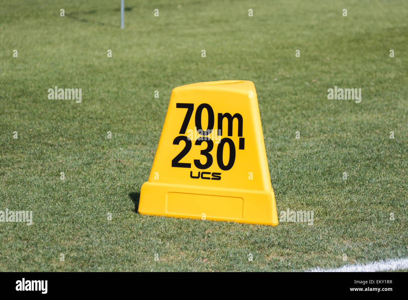 Track and field throwing Distance marker in feet and meters - Stock Image