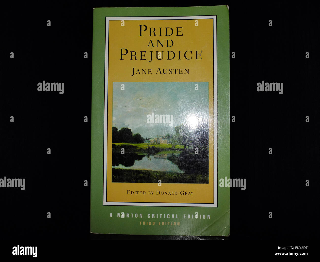 The front cover of Pride and Prejudice by Jane Austen photographed against a black background. - Stock Image