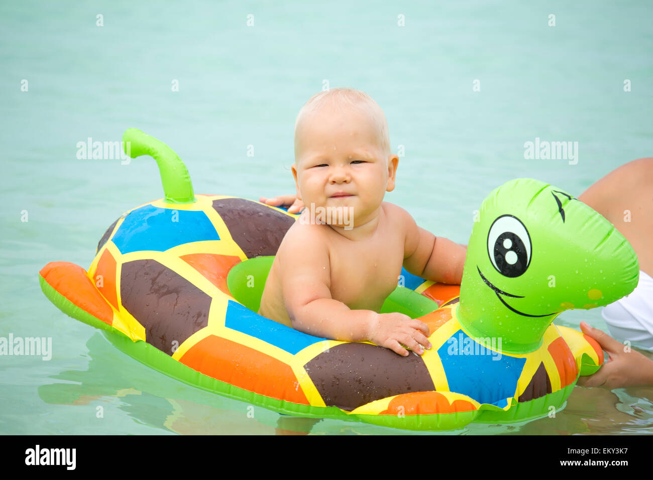 Baby bathing in the sea with swim ring Stock Photo: 81115531 - Alamy