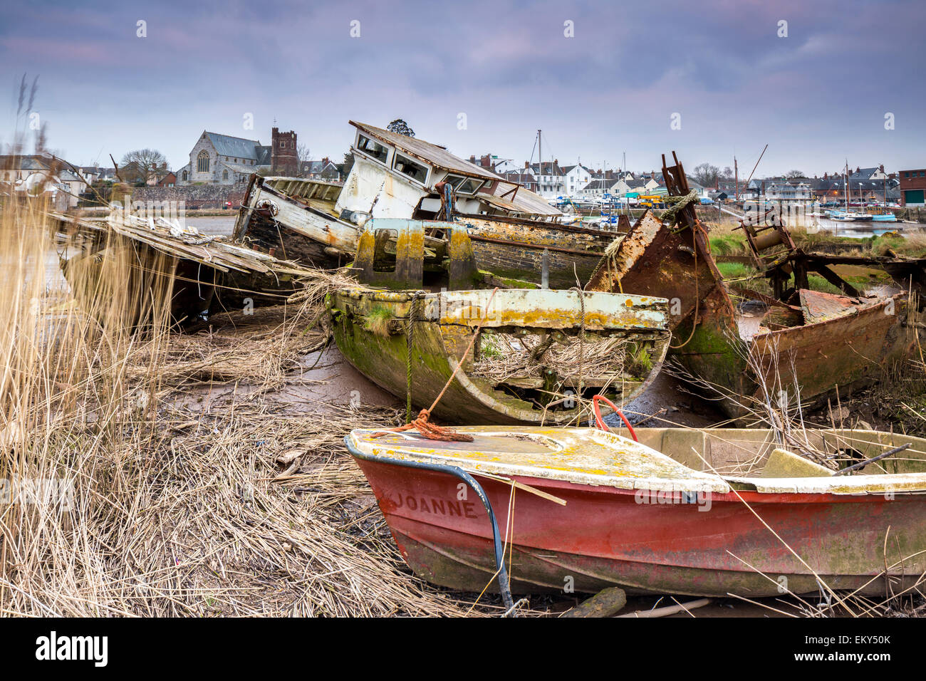 Old boats at low tide on the River Exe at Topsham, Devon, England, United Kingdom, Europe. - Stock Image