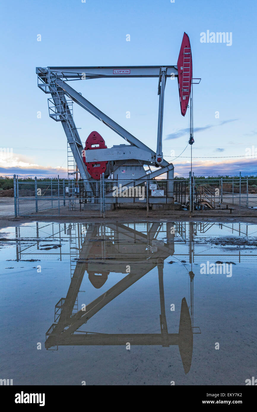 A pumpjack and surface water at oil well and fracking site in Shafter. Kern County, located over the Monterey Shale, - Stock Image