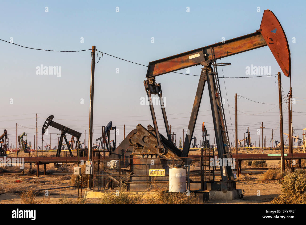 Pumpjacks at the Lost Hills Oil Field and hydraulic fracking site. Kern County, San Joaquin Valley, California, - Stock Image